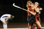 Pam Panchak/Post-Gazette  Fox Chapel's Jenna Alexander, right, celebrates with teammate Megan McCrady in the team's WPIAL Class AAA field hockey championship last Tuesday against North Allegheny.